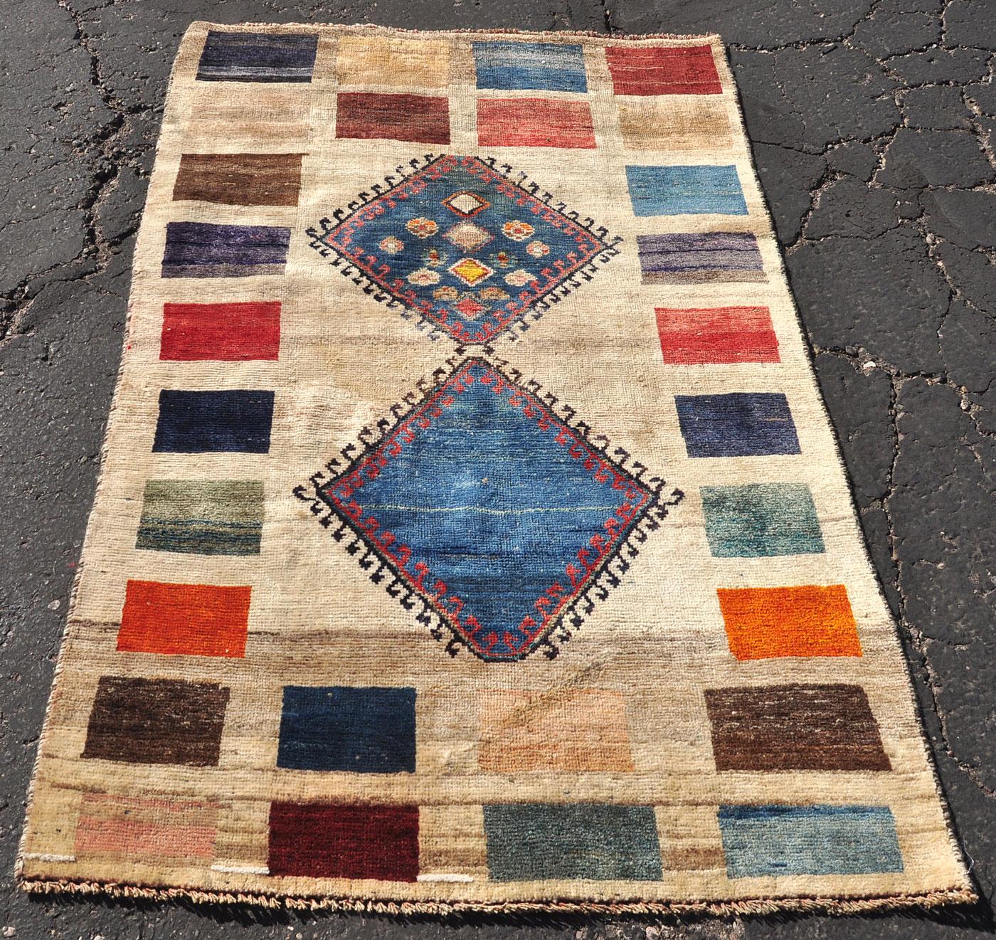 Hooked medallion gabbeh rug